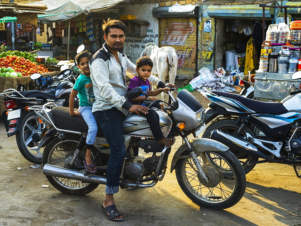 Father with two young sons on a motorcycle, Jaisalmer, Rajasthan, India