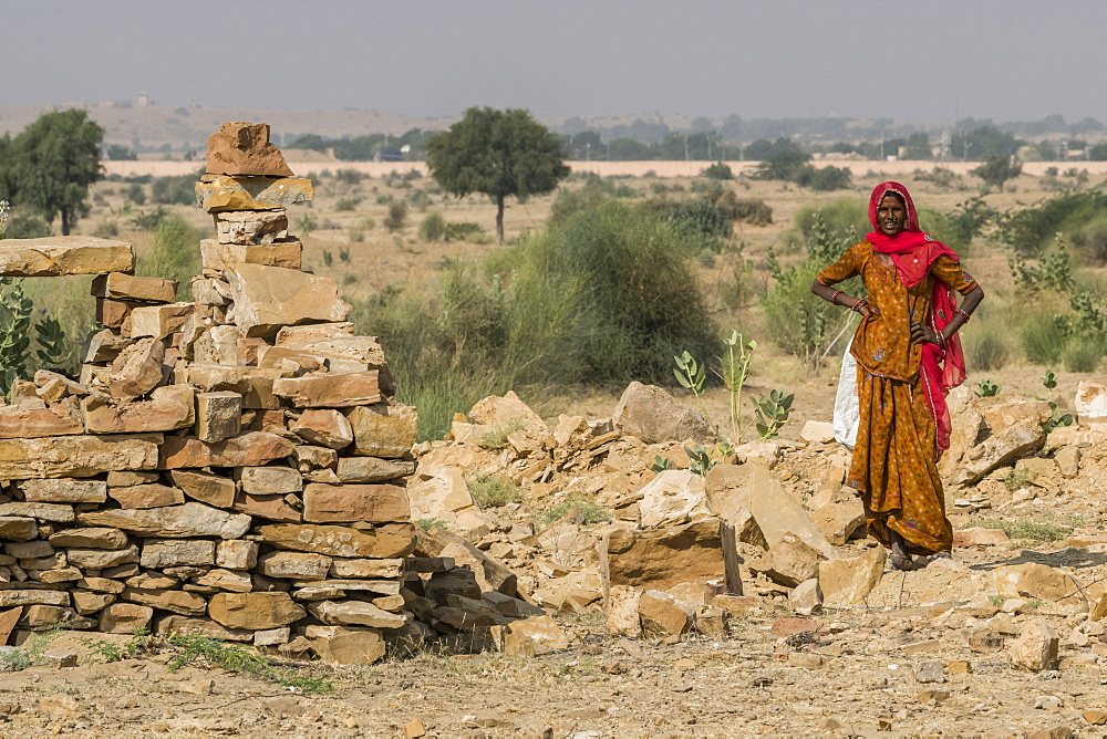 An Indian woman standing in Thar Desert, Jaisalmer, Rajasthan, India
