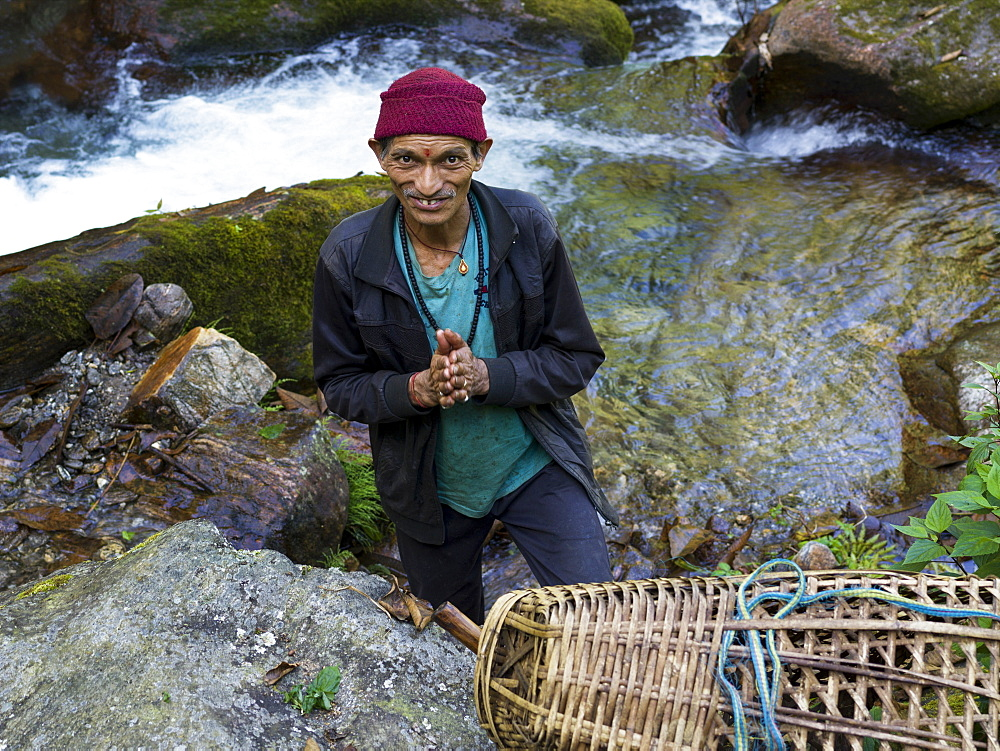 Portrait of a Hindu man standing near a stream and looking up, Bhalu Khop Village, Sikkim, India