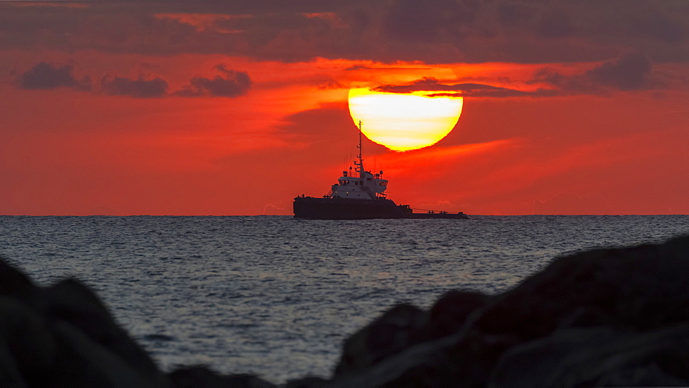 Tugboat in sunset viewed from Magic Island, Ala Monana beach park, Honolulu, Oahu, Hawaii, United States of America