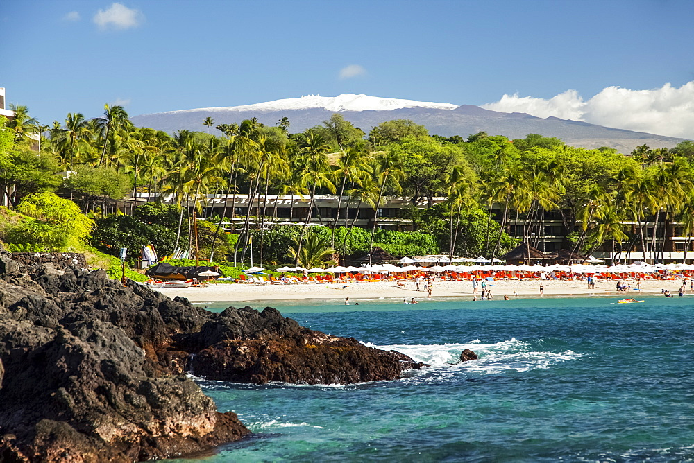 Kaunaoa Beach, Mauna Kea Beach and Hotel, and a view of Mauna Kea with snow on the Big Island, Island of Hawaii, Hawaii, United States of America