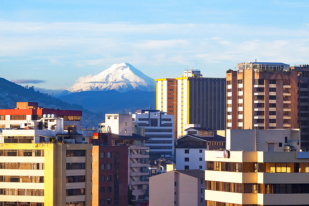 Quito, the capital city of Ecuador, and the Cotopaxi volcano. Cotopaxi is an active stratovolcano in the Andes Mountains, located in the Latacunga canton of Cotopaxi Province, Quito, Ecuador