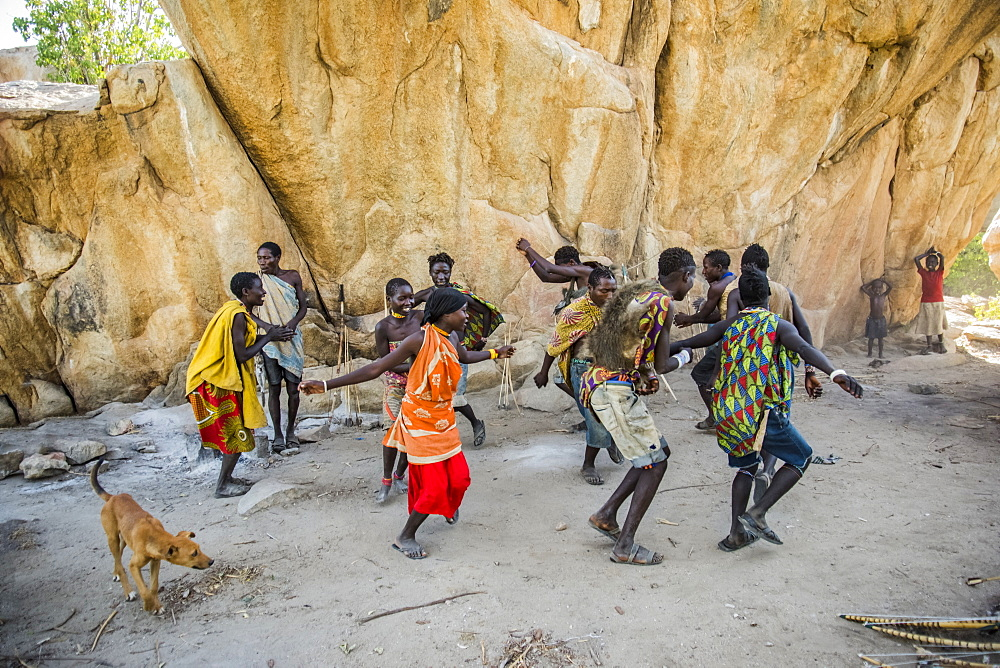 Hadzabe men and women dance and sing after a successful morning hunt near Lake Eyasi, Tanzania