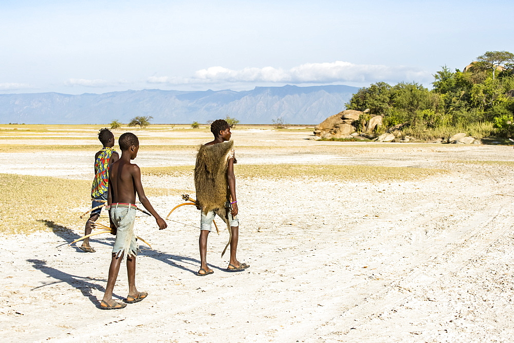 Hadzabe hunters returning to camp after a successful morning hunt near Lake Eyasi, Tanzania