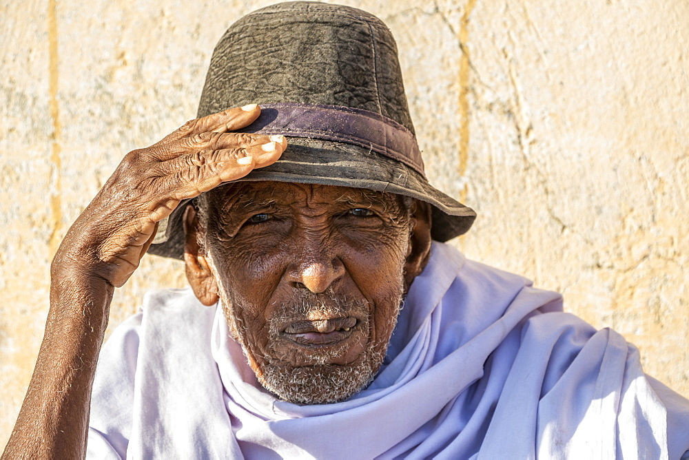 Portrait of an Eritrean man wearing a hat and looking into the camera, Monday livestock market, Keren, Anseba Region, Eritrea