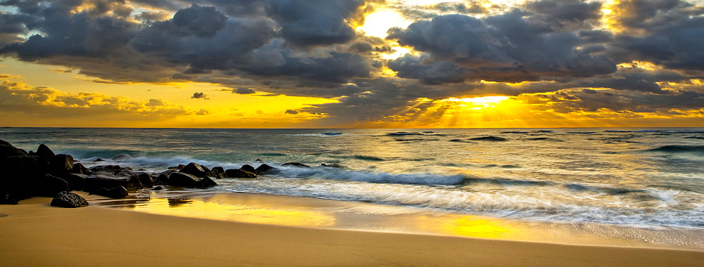 Sunrise from a beach on the coast of Kauai, Kauai, Hawaii, United States of America