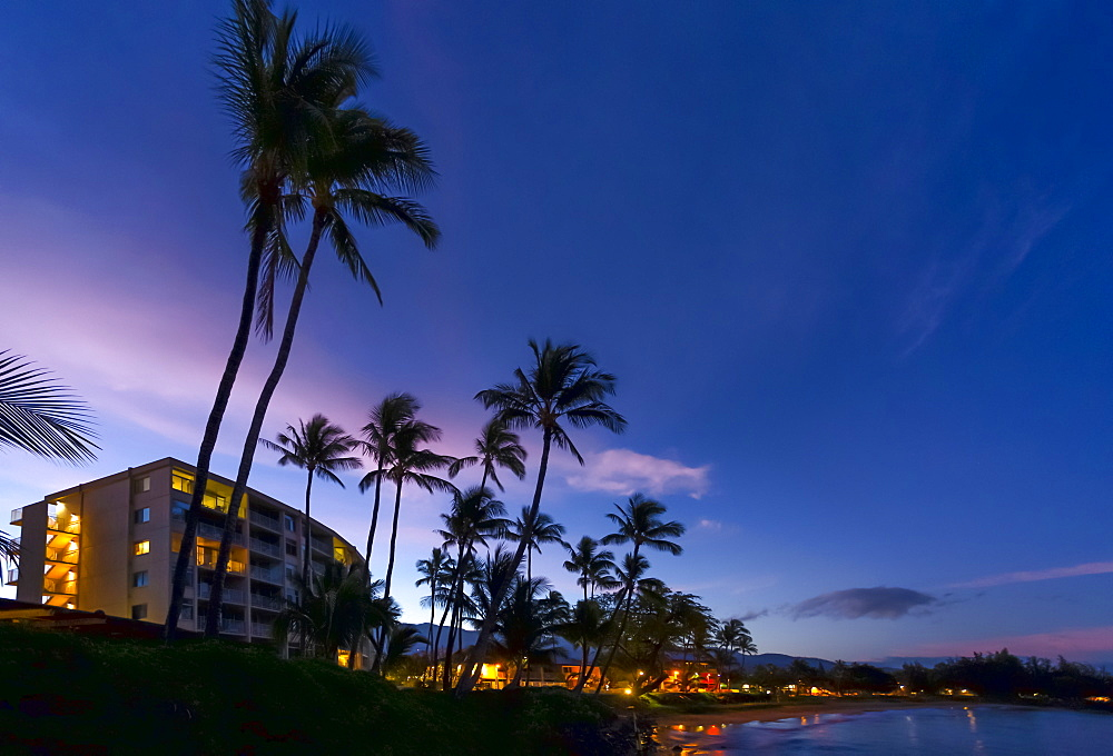 Hotels and palm trees along the coastline at sunset, Kamaole One and Two beaches, Kamaole Beach Park, Kihei, Maui, Hawaii, United States of America