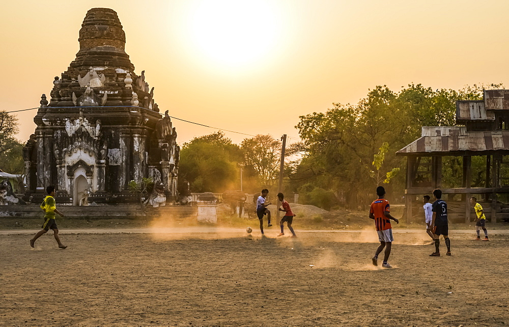 Boys playing football at sunset, Bagan, Mandalay Region, Myanmar