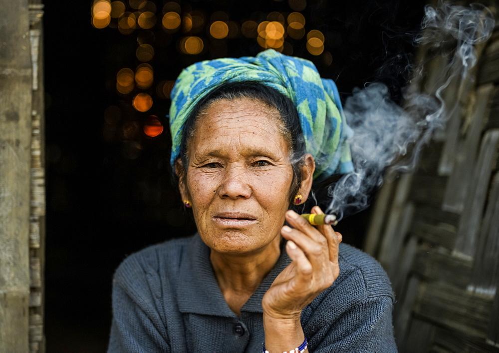 Senior woman smoking a cheroot, Taungyii, Shan State, Myanmar