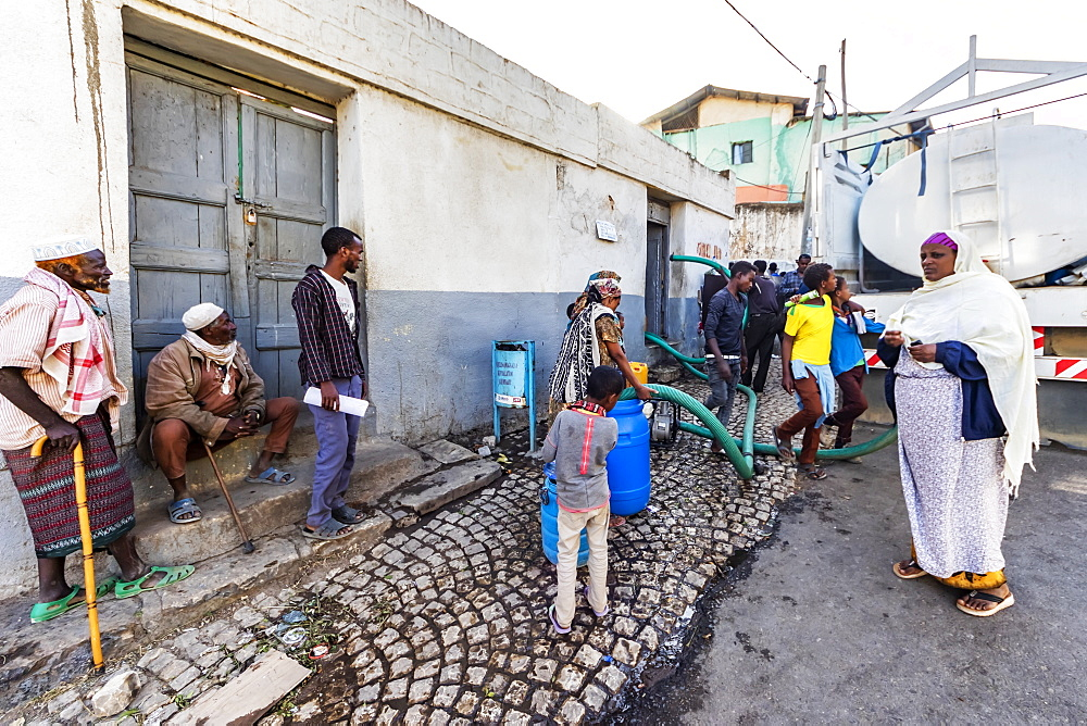 People by a water truck in Harar Jugol, the Fortified Historic Town, Harar, Harari Region, Ethiopia