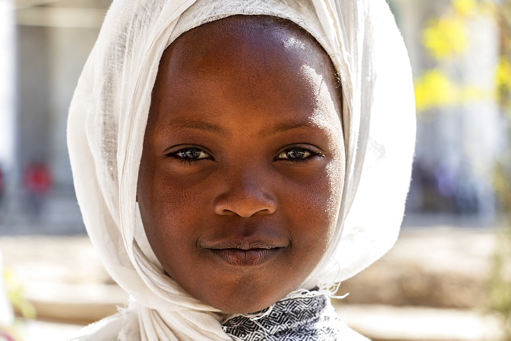 Portrait of a young Ethiopian girl at the Church of Saint George during Timkat, the Orthodox Tewahedo celebration of Epiphany, celebrated on January 19th, Ziway, Oromia Region, Ethiopia