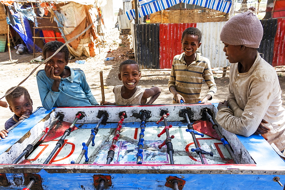 Ethiopian boys playing table football, Koka Reservoir (Lake Gelila), Oromia Region, Ethiopia