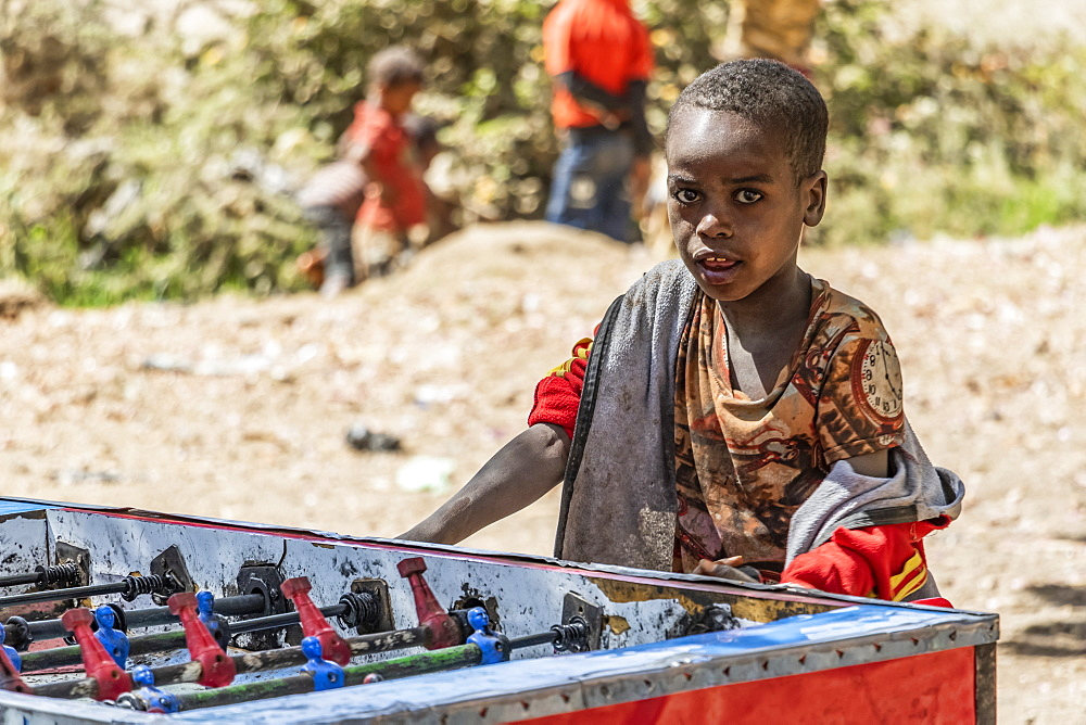 Ethiopian boy playing table football, Koka Reservoir (Lake Gelila), Oromia Region, Ethiopia