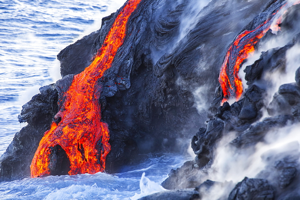 The Pahoehoe lava flowing from Kilauea has reached the Pacific ocean near Kalapana, Big Island, Island of Hawaii, Hawaii, United States of America