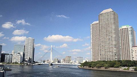Sightseeing Boat on Sumidagawa River with River City 21 with Ohashi Bridge