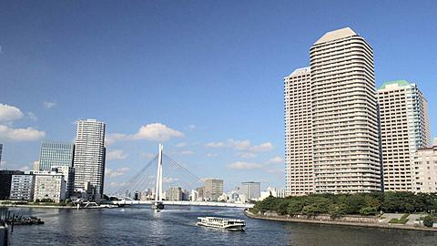 Sightseeing Boat on Sumidagawa River with River City 21 with Ohashi Bridge, Tokyo, Japan