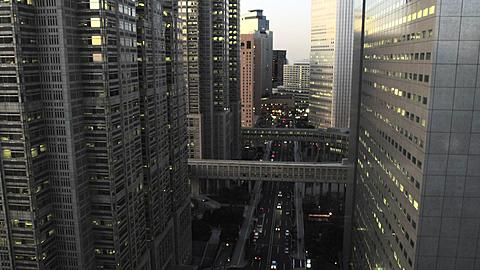 Elevated View of West Shinjuku Buildings in Tochou-dori Ave early Evening, Tokyo, Japan