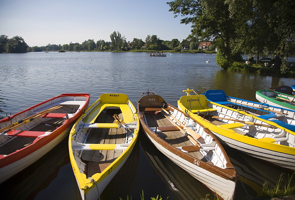 Rowing boats lined up on the Meare boating lake, Thorpeness, Suffolk, England, United Kingdom, Europe - 1121-14