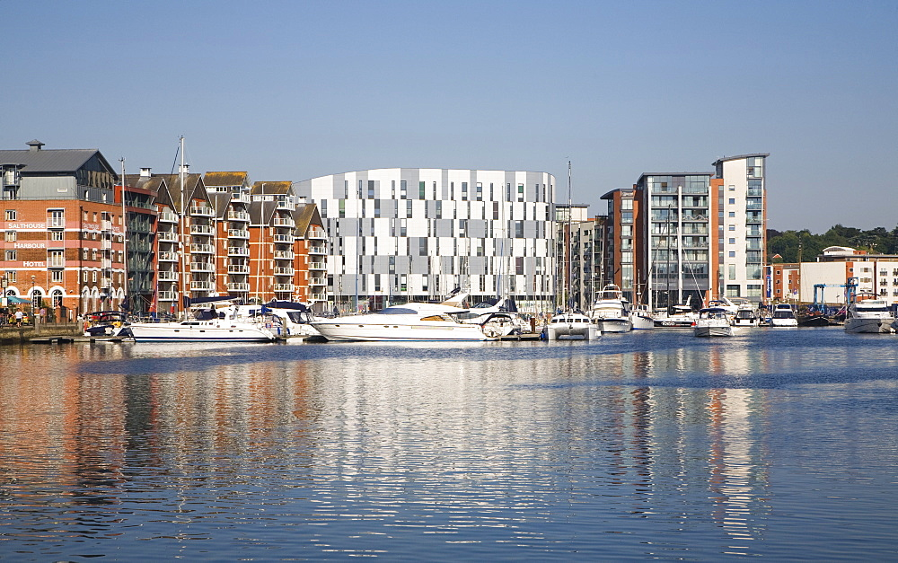 Boats in marina, modern apartments and University Campus Suffolk building, Wet Dock waterfront regeneration, Ipswich, Suffolk, England, United Kingdom, Europe - 1121-20
