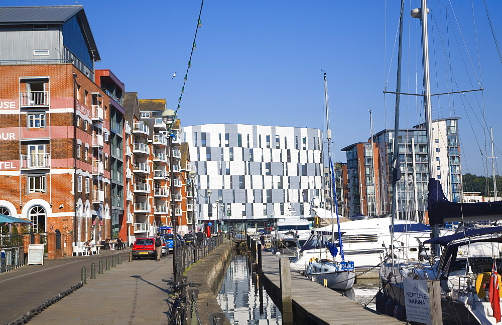 Boats in marina, modern apartments and University Campus Suffolk building, Wet Dock waterfront regeneration, Ipswich, Suffolk, England, United Kingdom, Europe - 1121-24