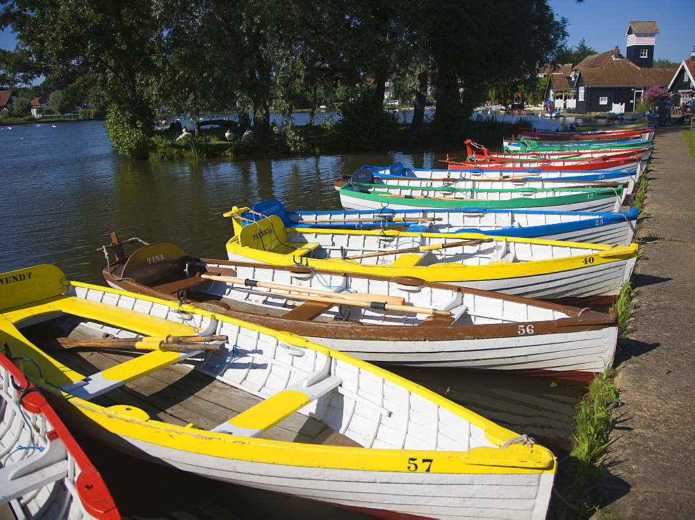 Rowing boats lined up on the Meare boating lake, Thorpeness, Suffolk, England, United Kingdom, Europe - 1121-3