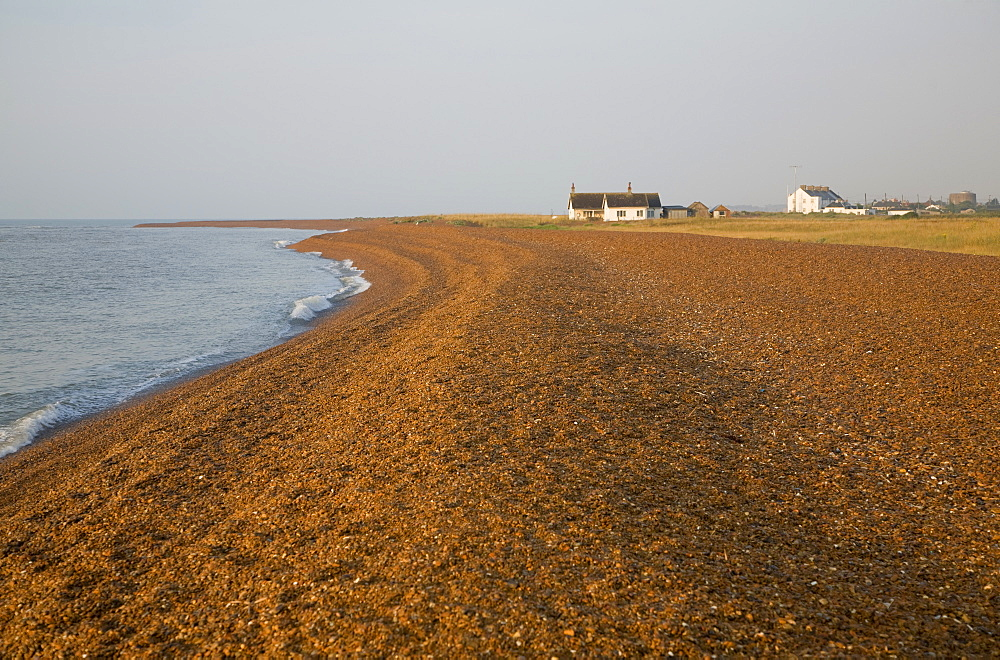 Isolated beach bungalow at the hamlet of Shingle Street, Hollesley Bay at the end of Orford Ness shingle spit, Suffolk, England, United Kingdom, Europe - 1121-30