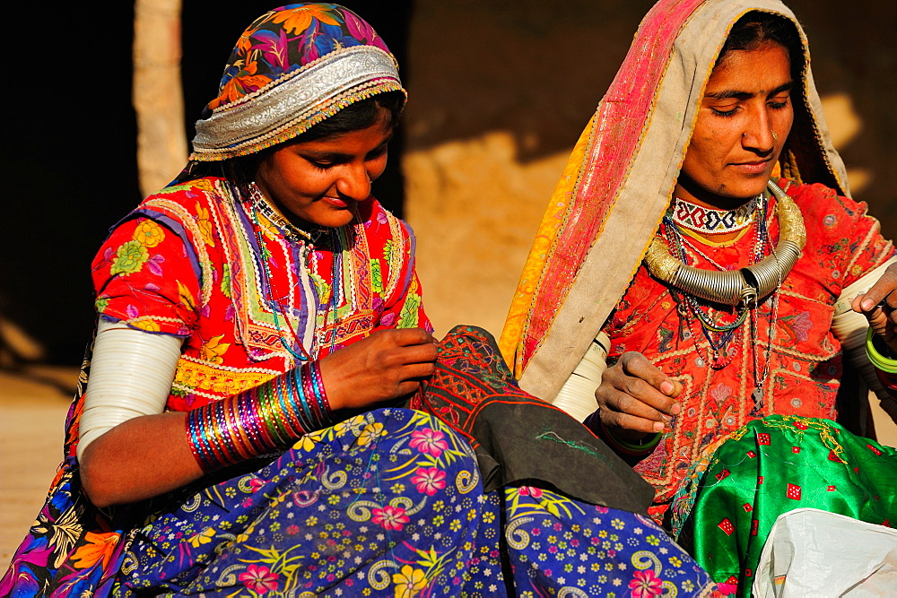 Mir tribal women with traditional attire doing embroidery work, Gujarat, India, Asia