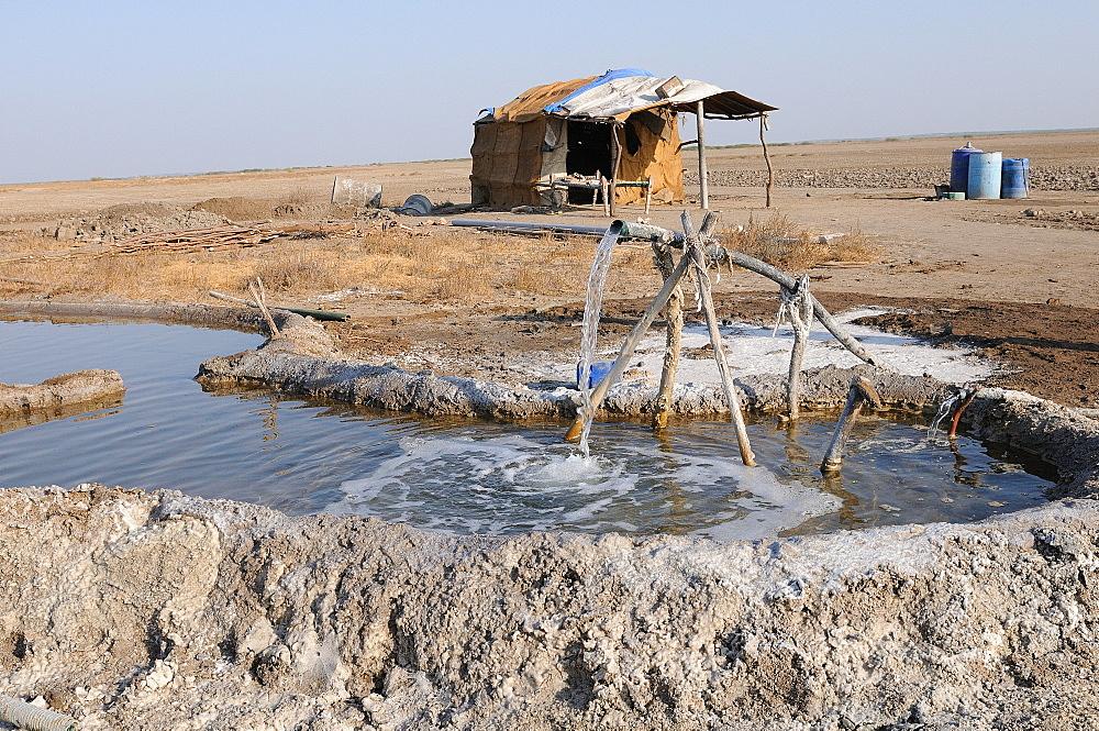 Salt making pit and salt worker's home, Gujarat, India, Asia