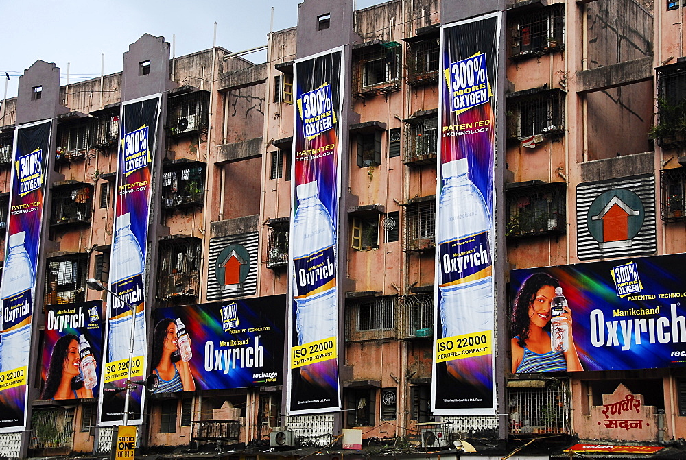 Advertisements on apartment buildings of Mumbai, Maharashtra, India, Asia