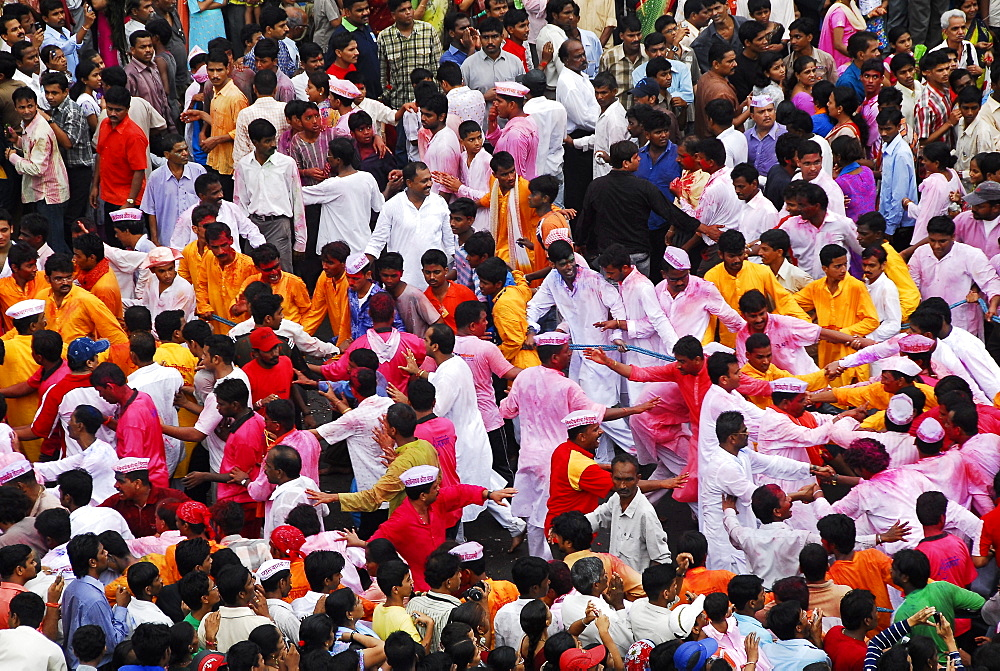 People forming a chain during the Ganesha idol procession to immersion, Mumbai, Maharashtra, India, Asia