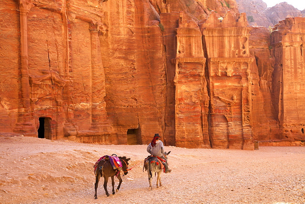 Bedouin with donkeys in front of the Outer Siq, Petra, UNESCO World Heritage Site, Jordan, Middle East