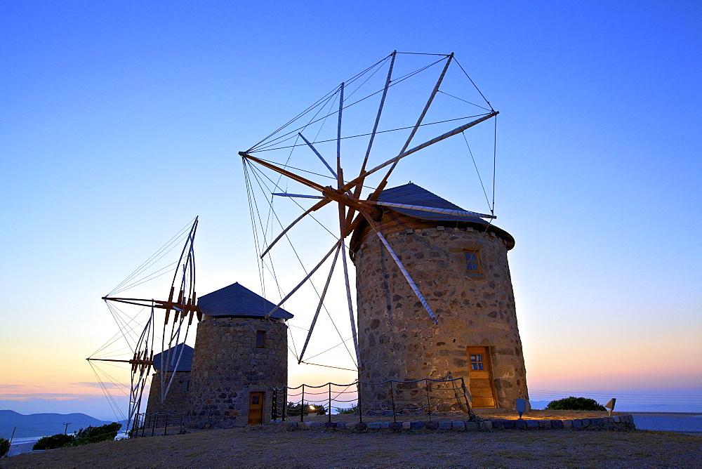 Illuminated windmills of Chora, Patmos, Dodecanese, Greek Islands, Greece, Europe