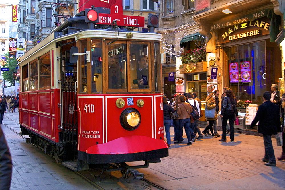 Historic red tram on Istiklal Caddesi, Beyoglu, Istanbul, Turkey, Europe  - 1126-760