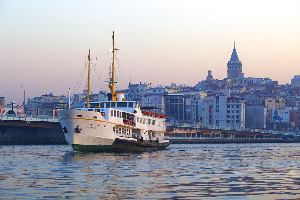 Ferry boat in Golden Horn with Galata Tower in background, Istanbul, Turkey, Europe