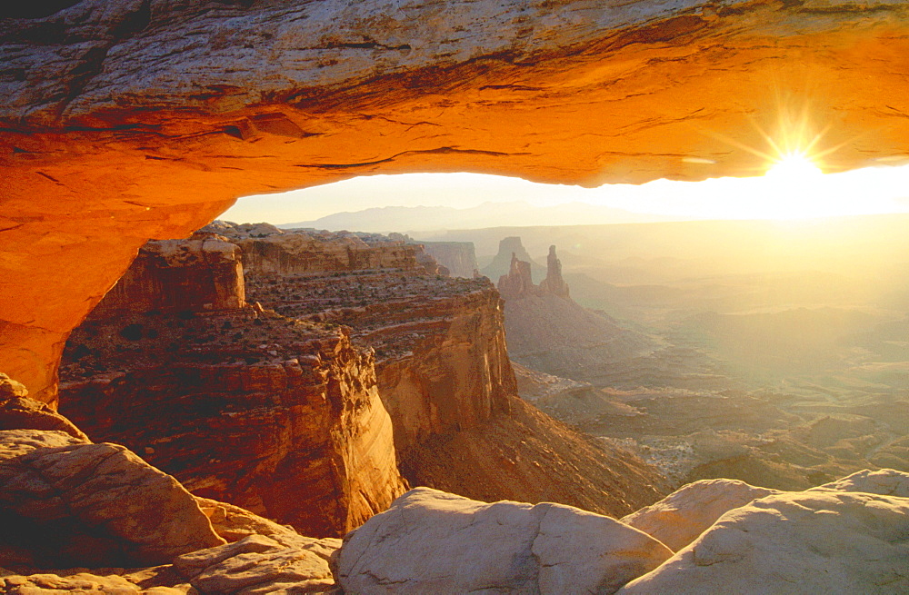 View on Washer Woman Arch through Mesa Arch, Canyonlands national park, Utah, USA