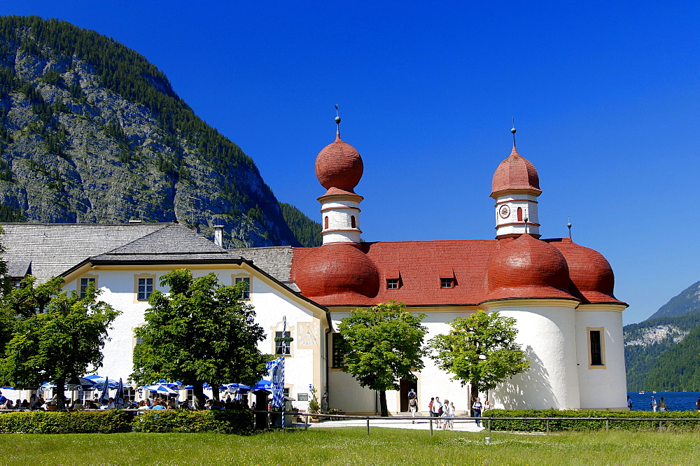 Pilgrimage church St. Bartholomae and restaurant with beer garden, Konigssee, national park Berchtesgaden, Bavaria, Germany / alps