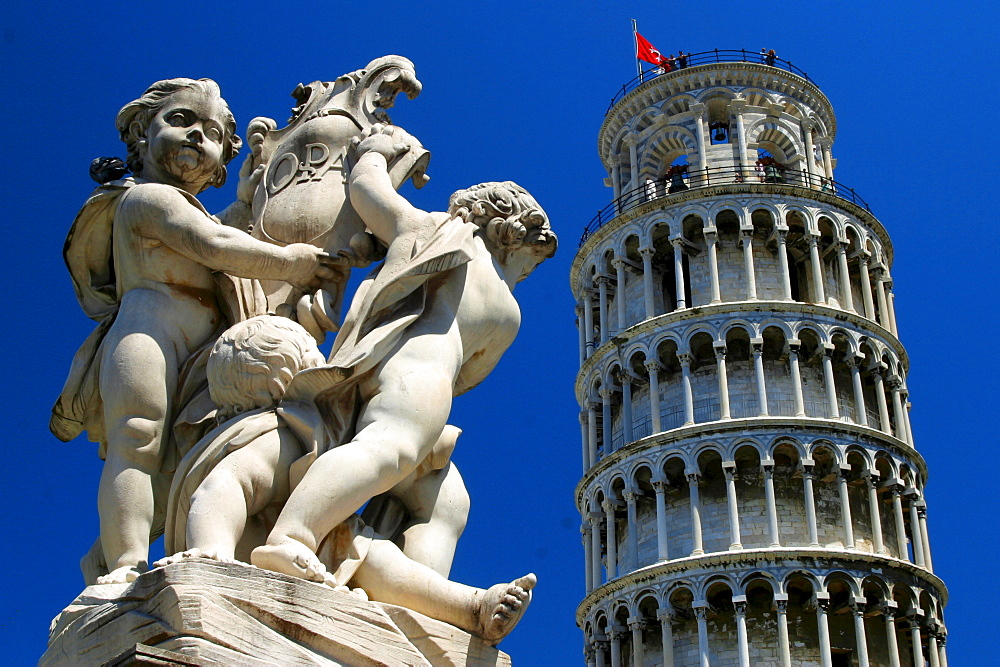Sculpture and Leaning Tower of Pisa, Tuscany, Italy