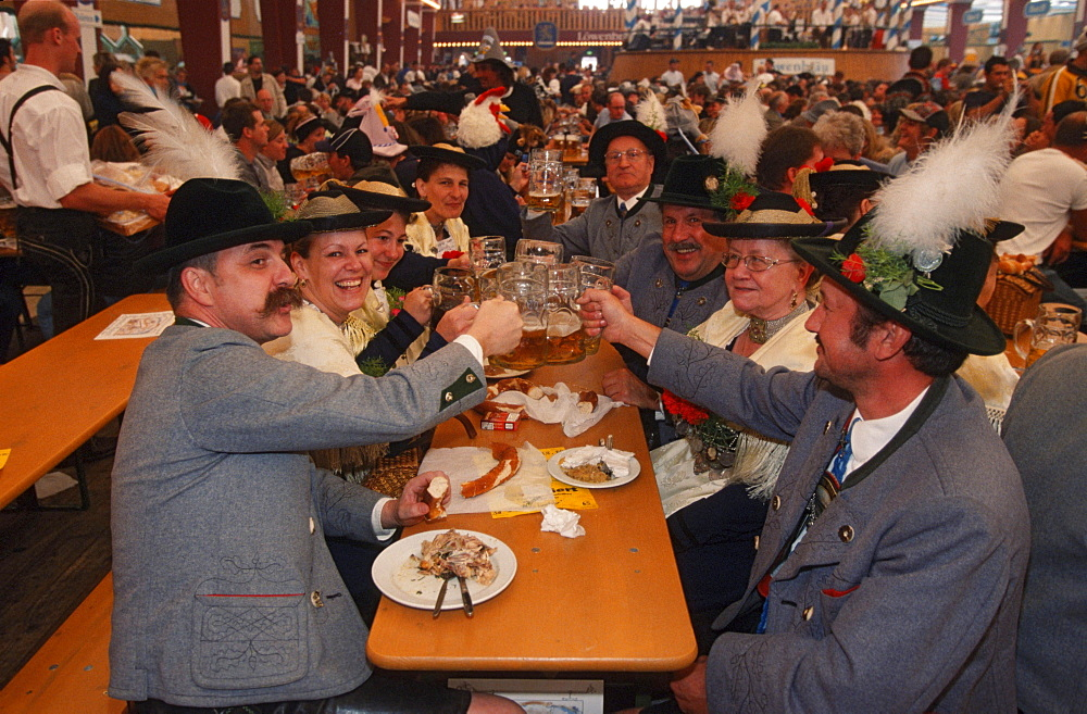 People in beer tent at Public Festival 'Oktoberfest', Munich, Bavaria, Germany / Munchen