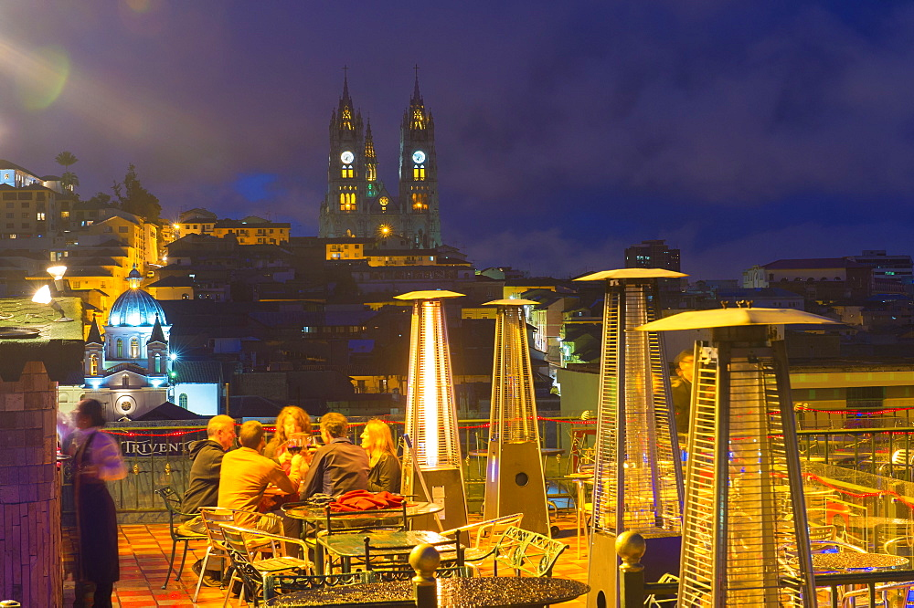 People on a terrace in front of the Basilica of the National Vow at night, Quito, Pichincha Province, Ecuador, Unesco World Heritage Site,