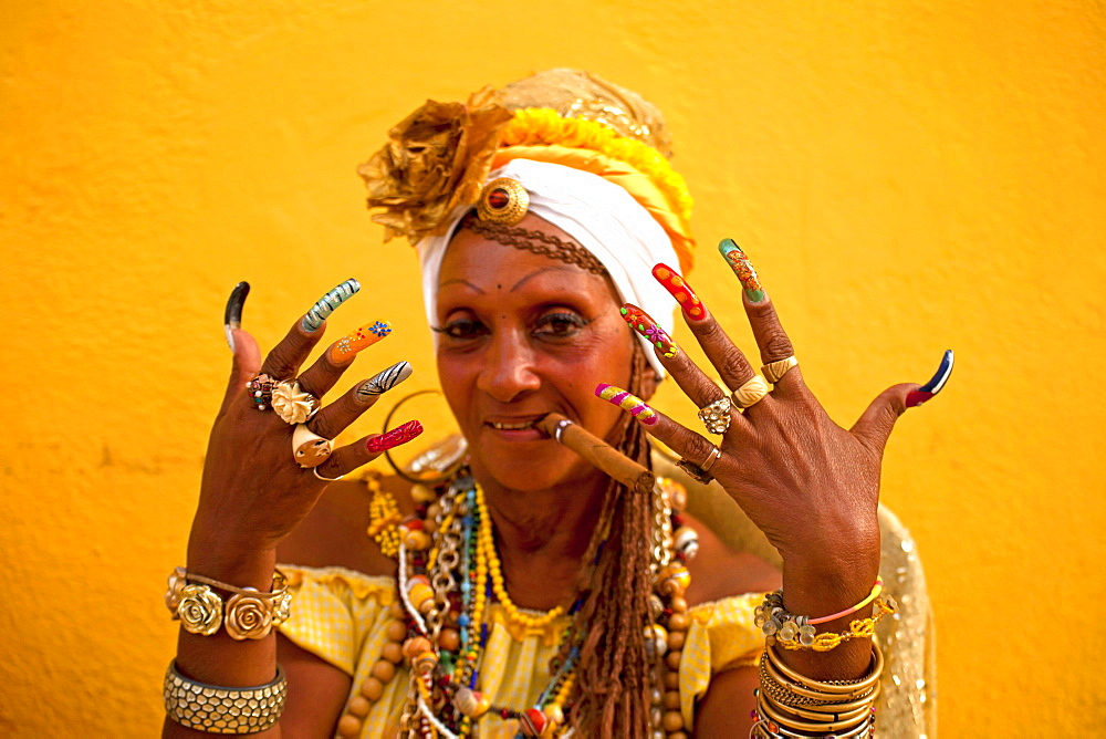 Senora Habana, A priestess of the afro-cuban Santeria with colourful long nails and cigar, Havana, Cuba, Caribbean