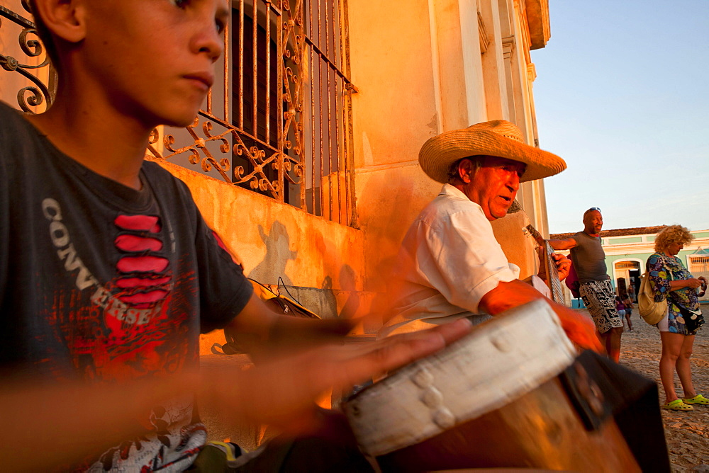 street musician Emerito Escalante Ramos and boy with drums in the old town of Trinidad, Cuba, Caribbean