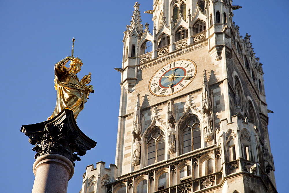 Virgin Mary atop the Mariensaule, new townhall, Neues Rathaus, central square Marienplatz, Munich, Bavaria, Germany / Mary's column