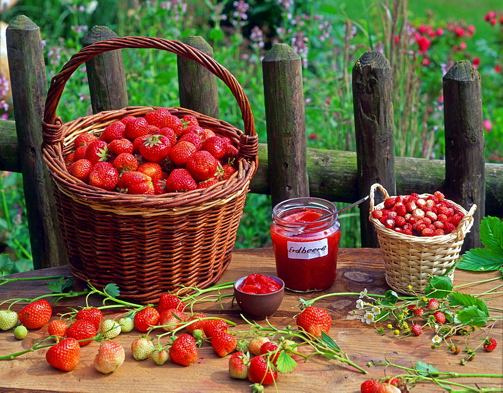 Strawberry jam and baskets with Strawberries