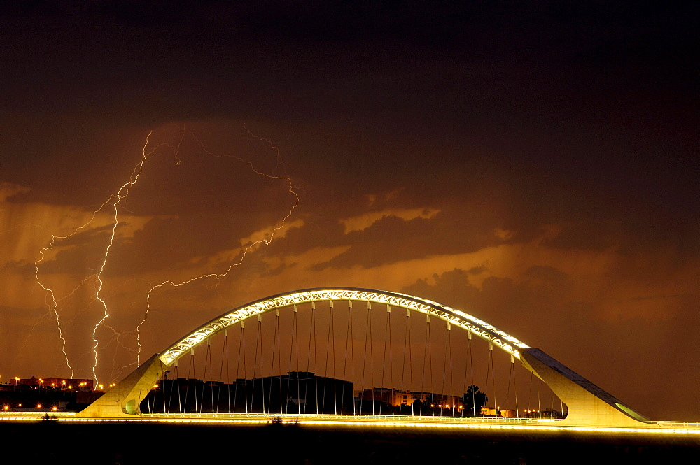 Lusitania bridge at night, over Guadiana river, Merida, Extremadura, Badajoz, Spain / Puente de Lusitania, architect: Santiago Calatrava, lightning