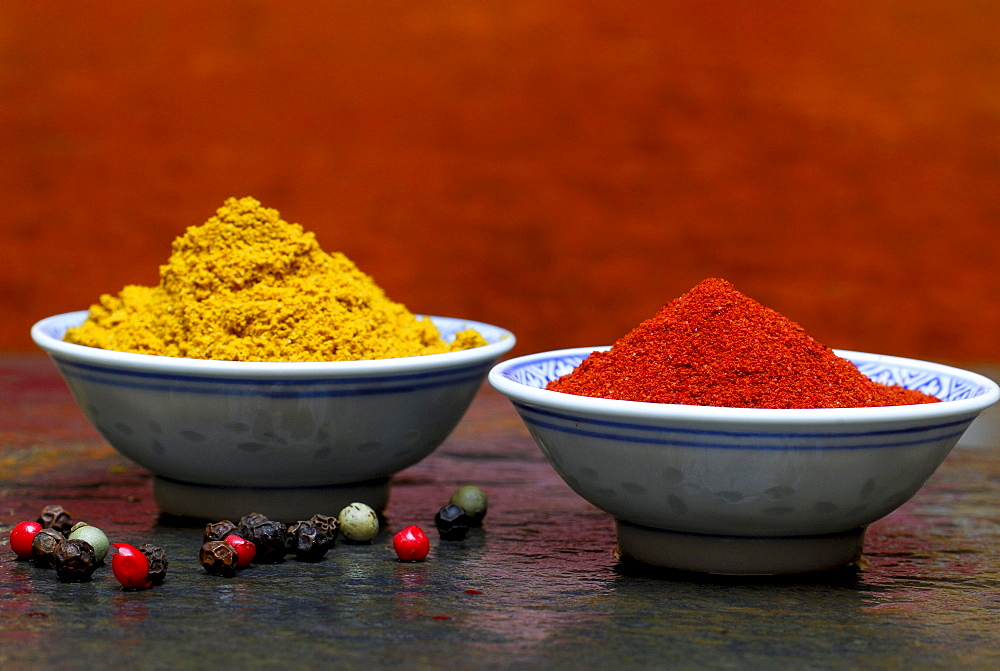 Peppercorns, paprika powder, curry powder, in bowl / pepper
