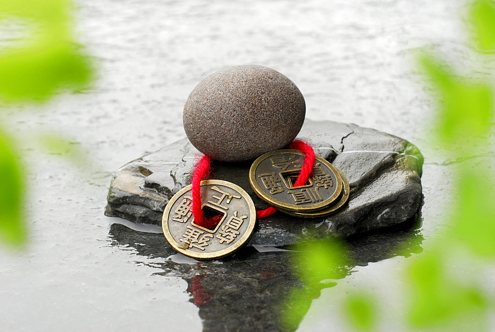 Stones and Chinese luck coins / fortune coins, water