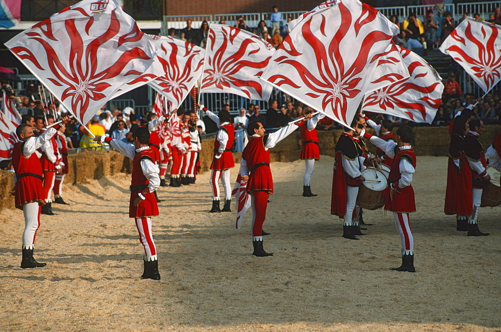 Standard bearer in traditional clothes, Palio parade, Alba, Piemont, Italy