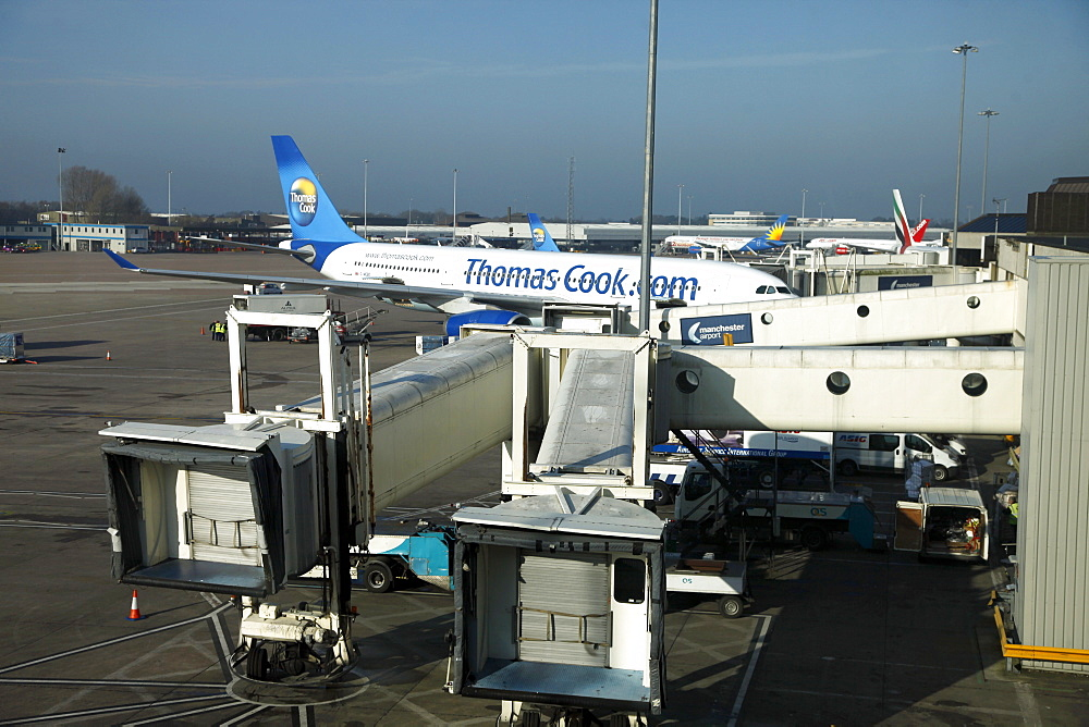 Thomas Cook aeroplane at gate, Terminal 1, Airport, Manchester, England, United Kingdom, Europe