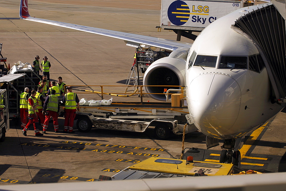 Turkish Airlines aircraft and baggage handlers, Terminal 1, Airport, Manchester, England, United Kingdom, Europe