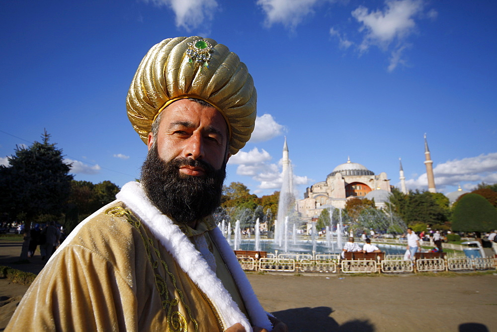 Man dressed as a sultan at Haghia Sophia Mosque (Aya Sofya), Istanbul, Turkey, Europe - 1130-1087